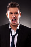 Angry young businessman shouting Royalty Free Stock Images