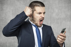 Angry young businessman shouting and screaming Stock Image