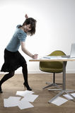 Angry Young Businesswoman Banging At Desk Royalty Free Stock Photos
