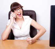 Angry young businesswoman receiving bad news Royalty Free Stock Images