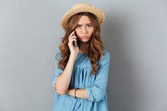 Angry young caucasian lady talking by phone. Photo of angry young caucasian lady talking by phone. Looking camera Royalty Free Stock Photography