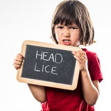 Angry young child holding a school slate as healthcare shield Royalty Free Stock Photo