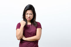 Angry young Chinese woman snarling at the camera royalty free stock photos