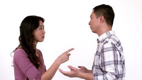 Angry young couple having a dispute. Against white background stock footage