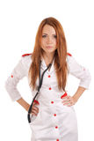 Angry young doctor with hands on hips Royalty Free Stock Photography
