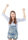 Angry young fashion girl in jeans overalls screaming isolated Stock Photo