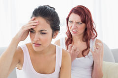 Angry young female friends having an argument Stock Photography