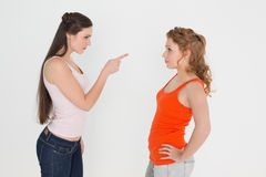 Angry young female friends having an argument Royalty Free Stock Photo