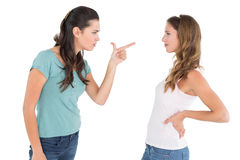 Angry young female friends having an argument royalty free stock photography