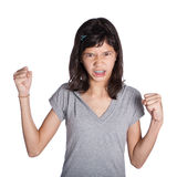 Angry young girl with fist in air Royalty Free Stock Image