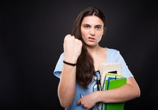 Angry young girl showing her fist Royalty Free Stock Images