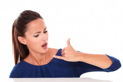 Angry young lady gesturing a call Stock Photo