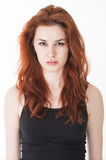 Angry young lady with red hair Stock Photos