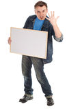 Angry young man with blank sign Stock Image