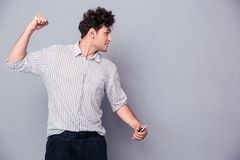 Angry young man clenching his fist Royalty Free Stock Photo
