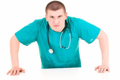 Angry young man doctor Stock Photo