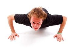 Angry young man doing push up Royalty Free Stock Images