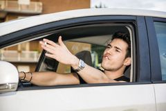 Angry Young Man Driving a Car and Yelling at. Handsome Angry Young Man Driving a Car and Yelling to someone in front of him royalty free stock photos