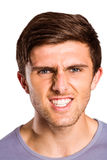 Angry young man growling at camera Royalty Free Stock Image