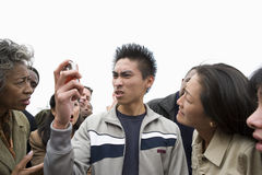 Angry Young Man Looking At Phone Stock Photo
