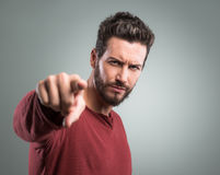 Angry young man pointing at camera Stock Photo