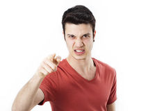 Angry young man pointing on you Royalty Free Stock Photos