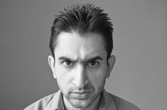 Angry young man portrait Stock Photography