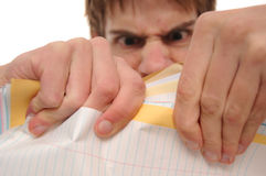 Angry young man ripping papers Royalty Free Stock Images