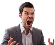 Angry young man screaming. Very angry man screaming out loud, great expression Stock Image