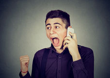 Angry young man screaming on mobile phone. Angry man screaming on mobile phone Royalty Free Stock Image