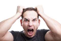 Angry young man shouts. Royalty Free Stock Photography