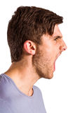 Angry young man with stubble shouting Stock Photos