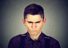 Angry young man about to have nervous breakdown. Isolated on gray background. Negative human emotion facial expression feeling reaction Stock Photography