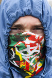 Angry young man. Young man wearing a hoody and a mask Royalty Free Stock Photography