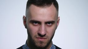 Angry young man On white Background. close up. slow motion.  stock footage
