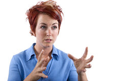 Angry. Young redhead waitress reacting to stress Royalty Free Stock Photography