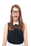Angry young teenage girl screaming isolated. On white background Royalty Free Stock Image