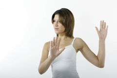 Angry young woman. In white Stock Photos