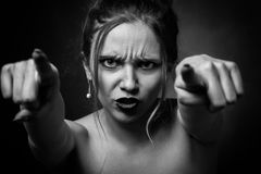 Angry young woman royalty free stock photography