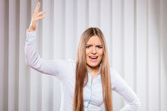 Angry young woman bussines shout. Handling stress and emotions in work. Frustrated female scream feel anger and irritation. Hands in air and open mouth. Formal Royalty Free Stock Image
