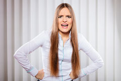 Angry young woman bussines shout. Handling stress and emotions in work. Frustrated female scream feel anger and irritation. open mouth. Formal dressed woman in Royalty Free Stock Images