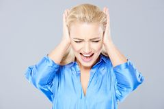 Angry young woman closing her ears Royalty Free Stock Image