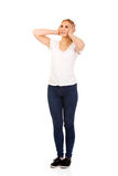 Angry young woman covering ears with hands.  Royalty Free Stock Photo