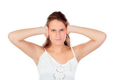 Angry young woman covering her ears Royalty Free Stock Photography