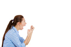 Angry young woman with fists in the air yelling Royalty Free Stock Photo