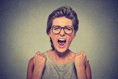 Angry young woman with glasses screaming Royalty Free Stock Photo