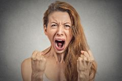 Angry young woman hysterical having nervous breakdown. Closeup portrait angry young woman hysterical having nervous atomic breakdown, screaming, fists up in air Royalty Free Stock Photo