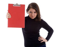 Angry young woman keeping red clipboard Stock Image