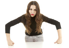 Angry young woman leaning on the white table Royalty Free Stock Image