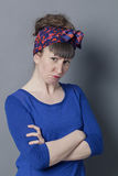 Angry young woman looking mad, standing with arms folded Royalty Free Stock Images